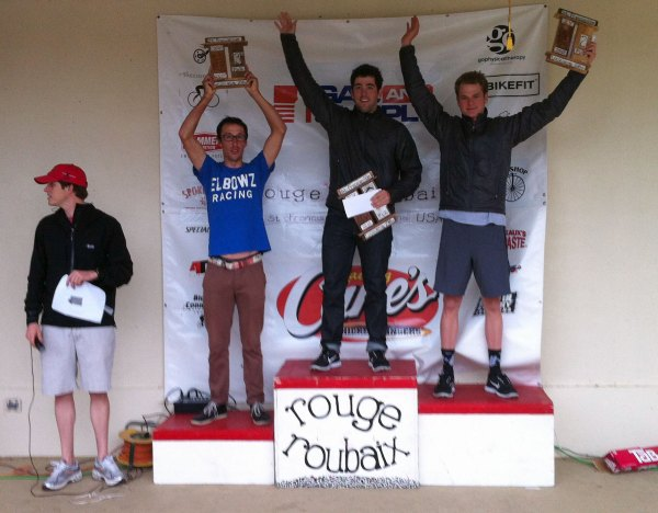 The Pro/1/2 podium (left to right) - Heath Blackgrove (Elbowz), Ty Magner (Hincapie), and Oscar Clark (Hincapie). Plus announcer / co-organizer Kyle Boudreaux