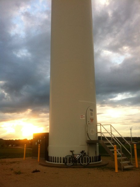 My bike at the base of a huge windmill (probably 100 feet tall with 50 foot blades