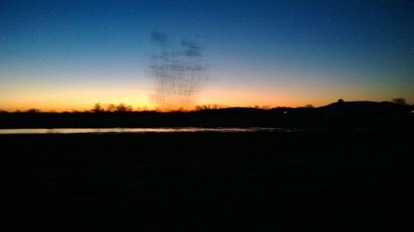 Sunrise and frozen lake