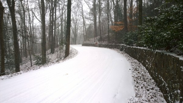 Tues 1/28 @ 11:03AM - Smyer Rd. As I descend Smyer Rd, I decide I want to get a picture of the road covered in snow. This is one of the most beautiful roads in Birmingham - with a few switchbacks, heavily forested, lined by a very old retaining wall. In 2004, a landslide caused by Hurricane Ivan wiped out a section of road about 3/4 of the way up. This section is just past the landslide area and is a bit more picturesque.