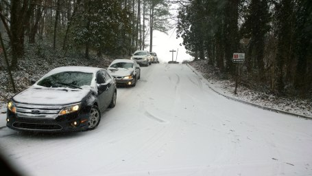 Tues, 1/28 @ 11:07AM - cherokee rd waiting! Decision time, I have to decide whether to cut through this office or the next one which has a fortress gate. The cars in this picture are stuck waiting and unable to leave because of the SUV unable to make it up the hill around the corner.