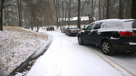 Tues, 1/28 @ 11:07AM - cherokee rd stuck! As I approach these cars from the other direction (coming down the hill), the SUV is spinning his tires and sliding sideways trying to get up the hill. He's got his window down so I roll up slowly and ask if I can get by real quick. He waits for me to pass before trying again. I turn around and snap this picture once I make it past the line of cars waiting to see if the SUV will make it.