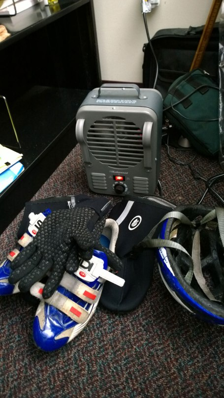 Tues, 1/28 @ 12:35PM - office warmup. By the time I make it to Samford, I am absolutely frozen having been out in temps in the mid teens for over 3 hours. I have a space heater in my office, so I put my shoes, shoe covers, and gloves in front of it to warm them up for the return trip while I instagram pics that I have taken on the way into campus.