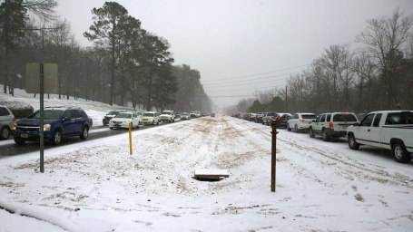 Tues, 1/28 @ 12:43PM - Lakeshore Dr at Samford University looking east. As I leave campus, I snap these two picture of Lakeshore Dr. This picture is facing east towards Hwy 31. Lakeshore Dr is not moving so that internally in Samford, traffic has backed up completely around the school. One of my students has already made it onto Lakeshore just out of frame on the right side of the picture. I say hi to him now and then later find out it took him two hours to make it the one mile from this spot to the next light where he parked his car to walk up the hill.
