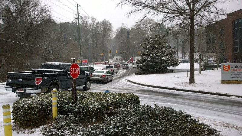 "Tues, 1/28 @ 12:49PM - Old Montgomery, Lakeshore Dr, and the Lakeshore Trail intersection. Cars unsuccessfully try to make it up the hill to the Lakeshore Foundation rehab center just past the light. I am thinking ""Where are they going to go? Lakeshore is a parking lot. There is no place to go."""