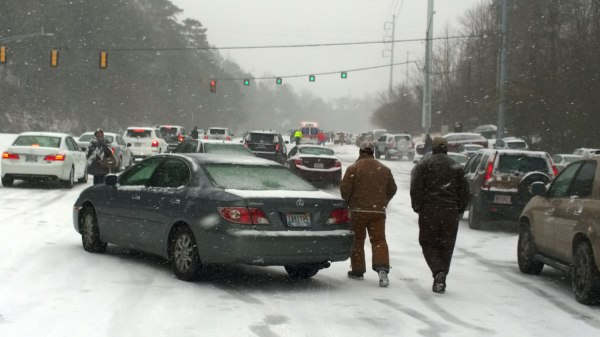 Tues, 1/28 @ 1:03PM - US Hwy 280 at Cherokee Rd. This is another defining moment. An ambulance spins out and struggles up the hill with a paramedic and a bystander behind it pushing it up the hill. People are abandoning their cars, while others try to get around. This is the spot where I started videoing heading up the hill. http://youtu.be/ZlKTOy0J8WI