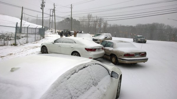 Tues, 1/28 @ 1:11PM - pileup at bottom of shades crest near 280 light. I take a close-up of the pile of cars at the bottom of the hill, unable to figure out how these cars ended up in this specific location and this specific arrangement. That would have been interesting to watch unfold in slow motion.