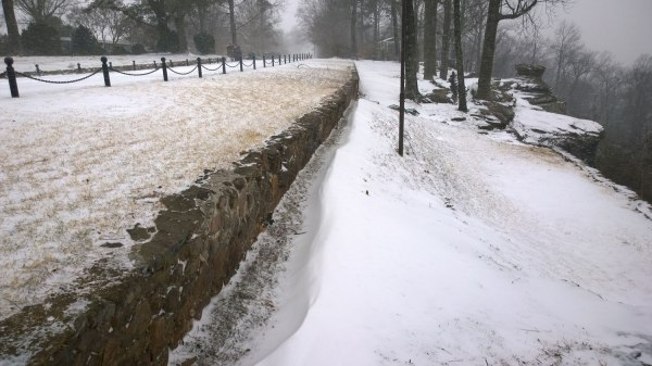 Tues, 1/28 @1:31PM - blowing and drifting snow vestavia dr overlook. As I return to this spot on Shades Mountain overlooking the highway 31 hill, I notice how much snow has drifted along the wall.