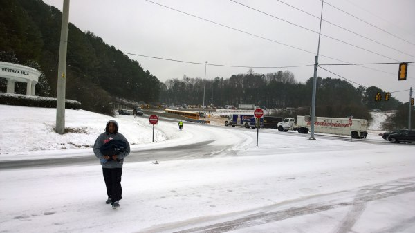 Tues, 1/28 @ 2:12PM - Looking south onto the I-65 ramps. I talk to the man in the foreground and find out he has just walked here from the interstate where his car had spun out and crashed into the median. We both nervously laugh at the situation and blown weather forecast, already a bit in shock at the complete chaos/gridlock. I-65 north is stopped at the foot of Shades Mountain blocking the on-ramp backing up to Hwy 31 and partially blocking it as well.