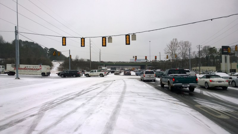 Tues, 1/28 @ 2:13PM - I-65 intersection at US Hwy 31 and Columbiana. Having made it all the way down Hwy 31 to the I-65 intersection, I encounter another scene of gridlocked traffic. To advance from this spot to Lorna, I have to ride the cement median all the way past the bridge. You can see in this pic that some cars have tried that as well.