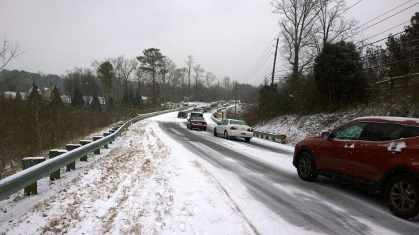 Tues, 1/28 @ 2:26PM - little shades creek hill rocky ridge rd. Just a little bit farther down the hill, I stop again to capture the scene of cars waiting in line to try the hill climbing up from the Little Shades Creek bridge. The white car has given up and is about the make a 3 point turn in front of me. After he turns around, I ride the left shoulder across the bridge and switch into the grass to get more traction. The road is already getting quite icy at this point.