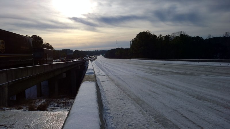 Wed, 1/29 @ 8:15AM - first view of I-65. The bridges shown here cross Wisteria Rd. I climb onto the interstate via the cement ramp under the bridges. I am shocked by what I see - completely stopped traffic on I-65 northbound and a completely empty interstate on I-65 southbound. The moment of me taking this picture is recorded at about 19 minutes into this video: http://youtu.be/31u73UqPQ4A.