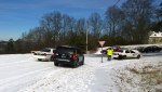 Wed, 1/29 @ 11:47AM - police chaining up. We take a different route to Columbiana - the I-65 climb to Alford Avenue and then across Shades Crest to this intersection with Columbiana. We arrive as a police officer puts chains onto his car. You can see the temporary barriers in place to prevent people from trying to go down the Columbiana Hill towards Lakeshore Dr.