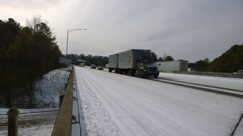 Wed, 1/29 @ 12:13PM - I-65 moving slowly. We climb back onto the interstate here to make it down to Lakeshore Dr. I-65 is starting to move again very slowly down the hill in one lane.