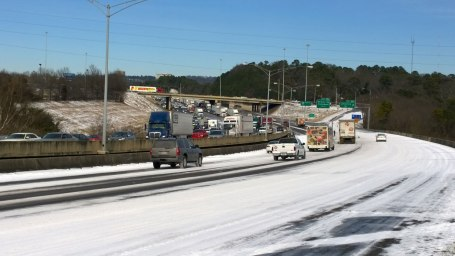 Wed, 1/29 @ 12:20PM - I-65 southbound parking lot. The reason why I-65 southbound was so empty through Hoover becomes painfully clear by the time we make it to Lakeshore Dr. Cars and trucks were not able to make it much farther than this spot until about this time when enough melting has occurred for this parking lot to slowly start to clear out as cars and trucks slowly climb the hill southbound.