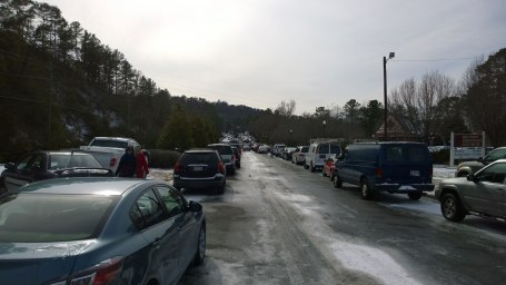 Wed, 1/29 @ 12:42PM - Columbiana Chaos. The scene we encounter on the climb up Columbiana from Lakeshore is nearly unbelievable. Again, there should be no cars visible in this picture other than maybe 3 or 4 driving on the road at this time of day. Instead, there are hundreds of cars parked in the median, in the right travel lane, on the shoulder, and off the shoulder. A few cars try to make it through the left travel lane, but it is still too icy and several turn around about halfway up.