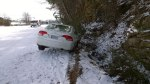 Wed, 1/29 @ 12:56PM - car ditch. Boris and I have no problems riding our mountain bikes back up the climb. At the top, we get a close-up of this car in the ditch with one wheel up in the air.