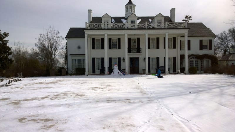 Wed, 1/29 @ 1:45PM - snowman golfer? Across Vestavia Dr, we encounter the first snowman. It's a huge one with a set of golf clubs and lots of American flags.