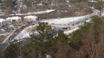 Wed, 1/29 @ 1:49PM - US Hwy 31 mess. Quite the traffic scenario has emerged on Hwy 31 by the time we make it to the Vestavia Dr overlook. If you zoom in on the high resolution picture, you can see cars crashed into each other in the southbound lanes at the Little Shades Creek bridge in the upper right-hand corner. For this reason, the southbound traffic has crossed over and is using the lefthand travel lane on the northbound side to head south. You can see somebody on a bike taking a picture on the Medical Center Dr bridge in the middle of the picture. You can also see sledding tracks on the side of the embankment!