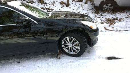 Wed, 1/29 @ 2:14PM - branch brakes. We chuckle at the tree branches that the owner of this car has used to make sure that his car doesn't go anywhere. It adds to the surrealness of an already surreal day. Given the 20+% hill this car got stuck on, this is a wise move by the car owner as there are reports of cars sliding on the ice after they have parked.