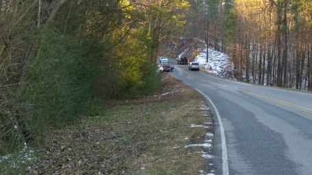 Thurs, 1/30 @ 4:23PM - Caldwell Mill Rd one lane. There were a lot of cars through here so I didn't stop to take a pic of the truck that had ran into a tree. In fact, the tree saved the truck from ending up all the way down in the bottom of the gulley. After stopping to slide down to the explorer, I come back up to the road and take this picture looking back at the truck and trailer blocking half the road.