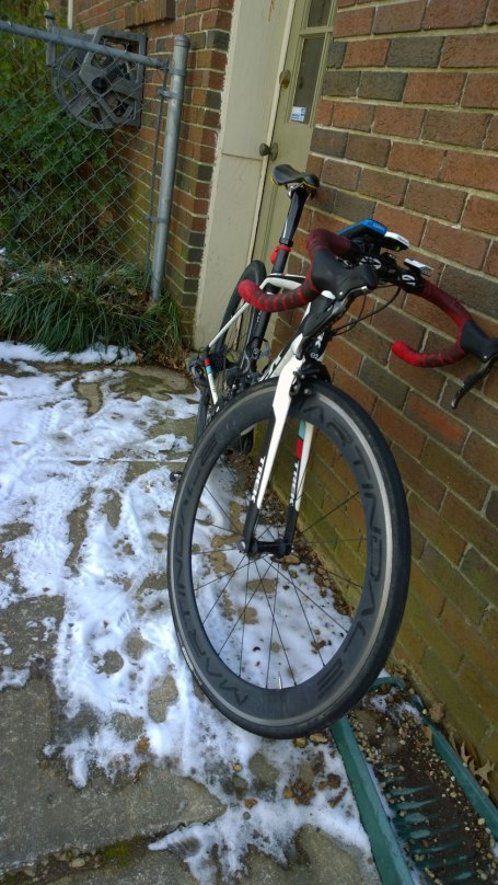 Fri, 1/31 @ 11:23AM - snow bike. I assume as I am leaving that all of the snow will be gone from the roads, so I take what I think will be one last picture of my bike in the snow. I was wrong.