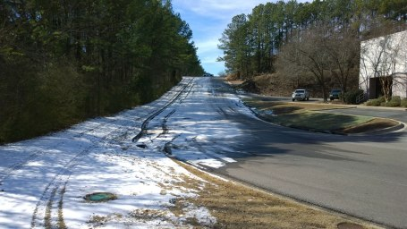 Fri, 1/31 @ 11:37AM - Dollar theater hill. A Hoover police cruiser blocks the top of this hill a couple miles from my house. I make it up with no probems by cutting through the parking lot and up the righthand side of the hill.