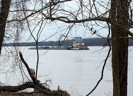 """Racing a barge on the Mississippi River - I just """"American Flyered"""" my ride."""