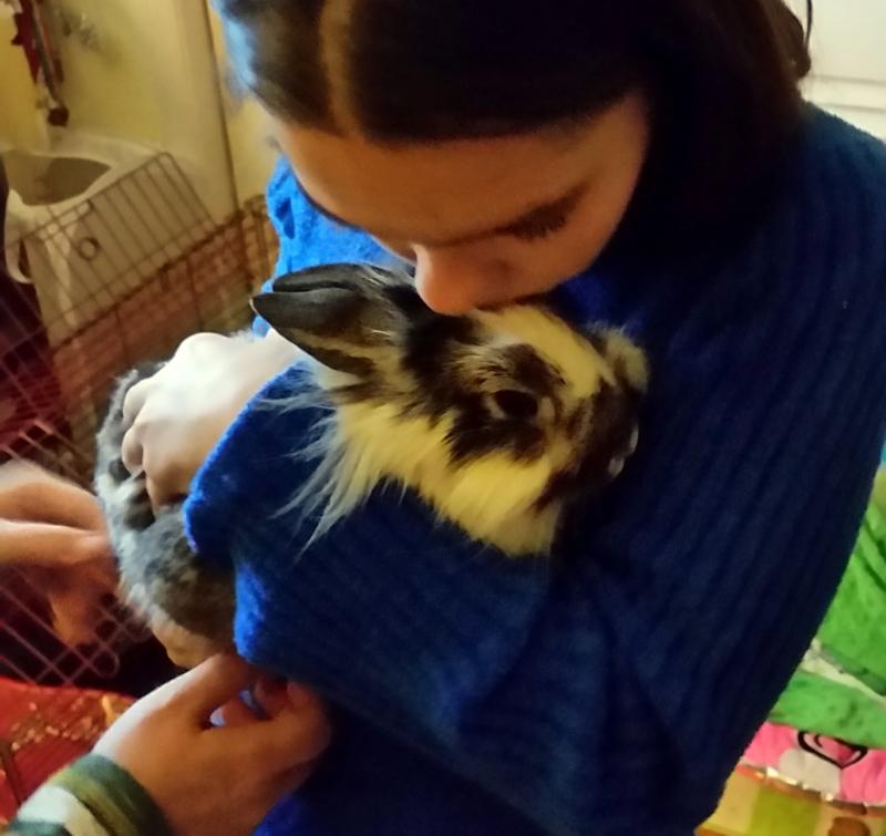 Analise holding and kissing Fluffy Steve on Thursday morning.